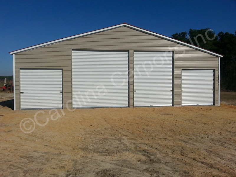 Fully Enclosed All with Garage Doors